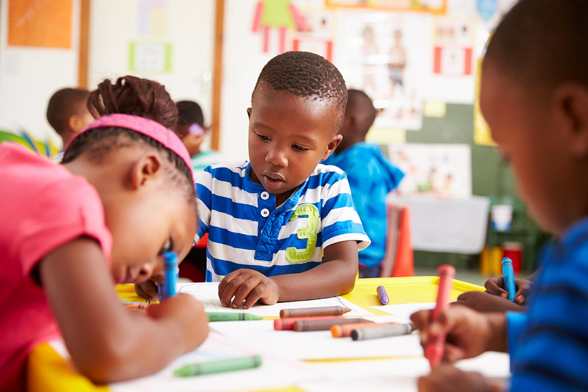 Children coloring at Early Learning Children's Academy