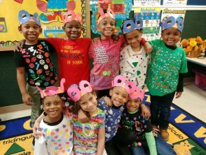 A group of children smile for the camera in a Bensalem preschool classroom