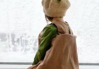 Snow Day Crafts for Indoors - A child is looking out a window at the snow outside